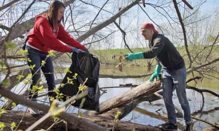 Photo Essay: Volunteers remove floating trash from local rivers