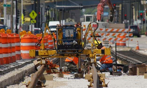 Crews reshape roadway as first streetcar rails installed
