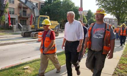 Mayor Barrett walks with Streetcar workers along Milwaukee's transit future