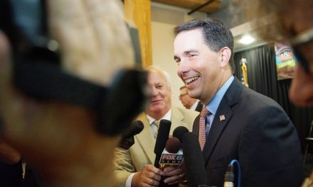 Outgoing Governor Scott Walker signs controversial legislation as parting snub to voters