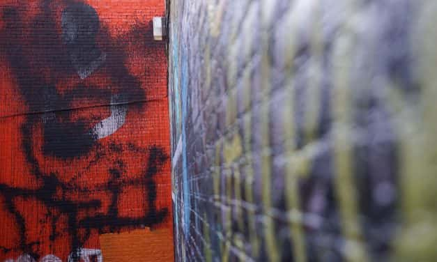 Unknown vandals deface social justice mural at Black Cat Alley
