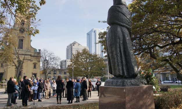Statue honoring immigrant motherhood rededicated at Cathedral Square Park