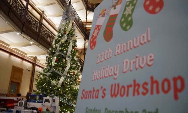 Santa's helpers prepared holiday gift drive donations for USO party