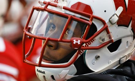 Brain injury proof piles up while Wisconsin football players downplay warnings