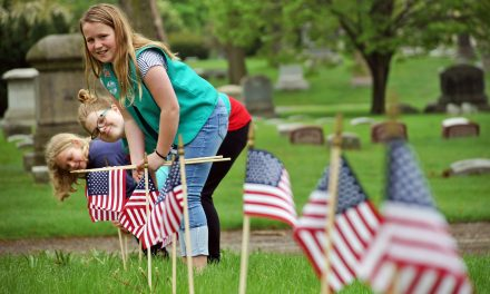 Girl Scouts navigate cemetery labyrinth to plant American flags in honor of veterans