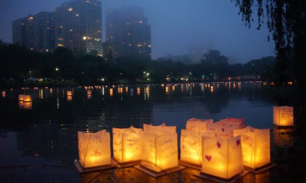 Illuminated wishes floated across a foggy lagoon for first Water Lantern festival
