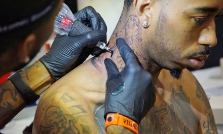 Art collectors get colorful body modifications with tattoos at annual convention