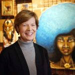 Senator Tammy Baldwin celebrates Sherman Phoenix's success during visit with business owners