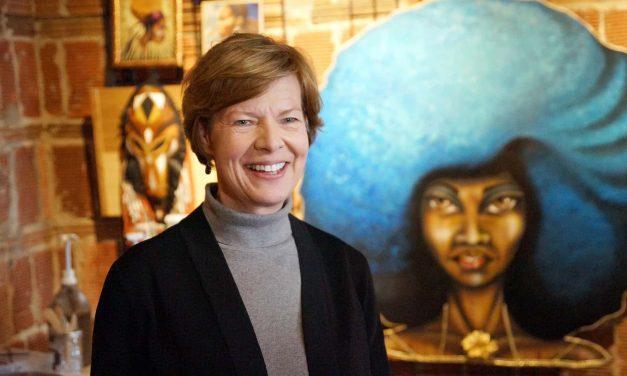 Senator Tammy Baldwin celebrates Sherman Phoenix's success during visit with business owners