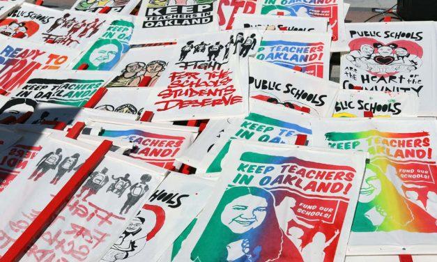 Milwaukee educator behind illustrated signs at historic Oakland teachers strike
