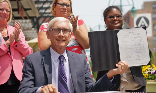 Governor Tony Evers visits Milwaukee to sign law expanding electric transportation options