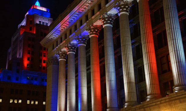 We Need Each Other: Downtown Milwaukee buildings illuminate the darkness with beacons of hope