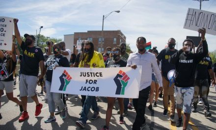 Peaceful protesters in Kenosha march with Jacob Blake's family demanding an end to police brutality