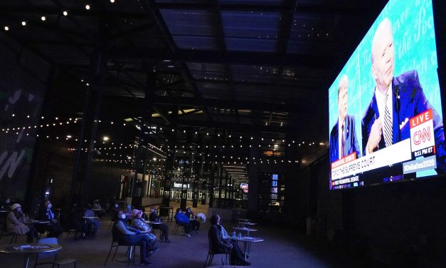 A hot mess inside a dumpster fire: Milwaukee's Democratic supporters watch first presidential debate
