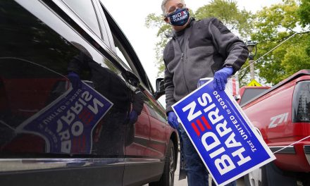 Milwaukee's Latino voters pick up Biden-Harris yard signs to declare their election day support