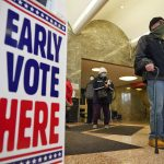 Milwaukee voters line up amid an escalating pandemic to cast early in-person ballots