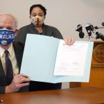 Healing a racial division: Mayor Tom Barrett signs ordnance extending MLK Drive into downtown