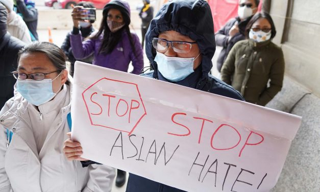 Milwaukee residents hold vigil by City Hall to demand an end of the violence targeting Asian Americans