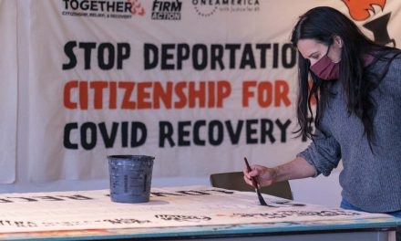 "Art build in Milwaukee creates banners for nationwide ""torch relay"" march in support of immigrant rights"