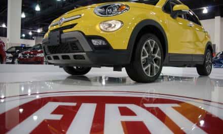 Visitors kick the tires at Auto Show