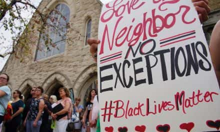 Photo Essay: Faith group stands up to racism with silent vigil