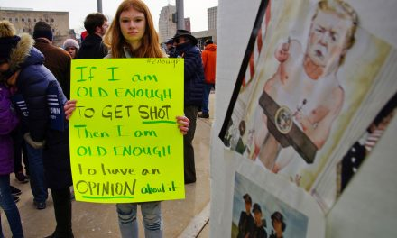 """Messages to NRA shown on signs at """"March for Our Lives"""" in Milwaukee"""