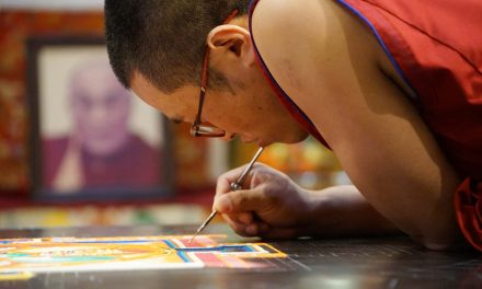 Tibetan monks share culture in colored mandala painted with sand at Milwaukee City Hall