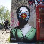 Graffiti artists and muralists send messages of hope and despair with coronavirus public art