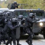 """A """"Forever War"""" at Home: Why a militarized police force sees American citizens as enemy combatants"""
