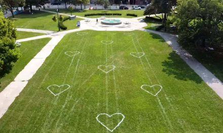 Painted hearts encourage residents to enjoy downtown parks while remaining socially distant